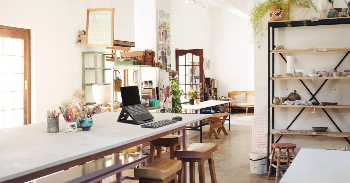Laptop riser on desk of modern office